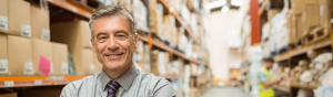 Man in shirt and tie in warehouse - lone worker safety
