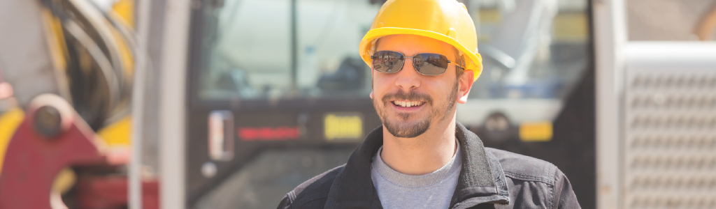 Worker outside, sun glasses, beware of the dangers of summer. IOSH Managing Safely.